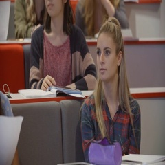 Tilt shot of students in a university lecture theatre Stock Footage