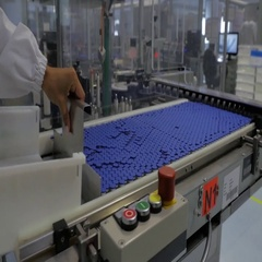 drug industry -  blue caps for vials Stock Footage
