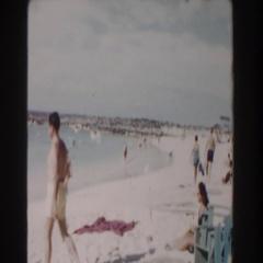 1961: random people walking alongside the ocean. NASSAU Stock Footage