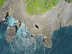 Aerial shot of the Nusa Dua peninsula island and waterblow hole area Stock Footage