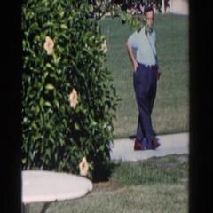 1961: people standing in a yard on the sidewalk NASSAU Stock Footage