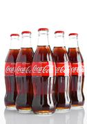 Classic bottles Of Coca-Cola on white background with frost Stock Photos