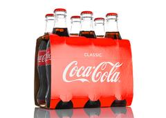 Classic bottles Of Coca-Cola six pack on white background . Stock Photos