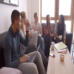Students Relaxing In Lounge Of Shared Accommodation Stock Footage