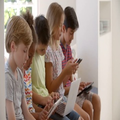 Group Of Children Sit On Window Seat And Use Technology Stock Footage