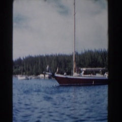 1961: a boat sitting sitting in the water at the shore line NASSAU Stock Footage