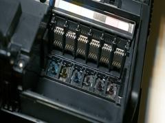 Man using syringe to clean CMYK printer inkjet Stock Footage