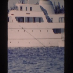 1961: large white vessel lying in the blue water of the lake NASSAU Stock Footage