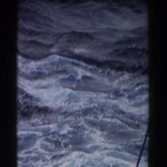 1959: turbulent sea with froths formed in the waves on a sunny day Stock Footage