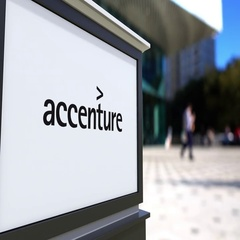 Street signage board with Accenture logo. Blurred office center and walking Stock Footage