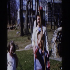 1959: family outside enjoying the fall weather and each other's company  Stock Footage