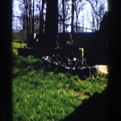 1959: green field inside a fence with a house MICHIGAN Stock Footage