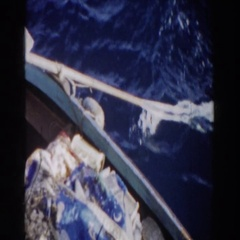1959: view of an oar pulling in the water from a boat. GIBRALTAR Stock Footage
