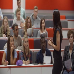 Female teacher and students in university lecture theatre Stock Footage