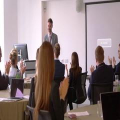 Delegates Applaud Businessman After Presentation Shot On R3D Stock Footage