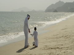 Father and son playing with soccer ball at the beach. Stock Footage