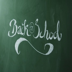 Back to school, man cleaning text from chalkboard, close up, shot on R3D Stock Footage