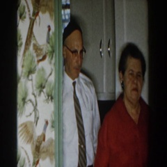 1959: an elderly jewish couple enter the dining room prepared for a seder meal Stock Footage
