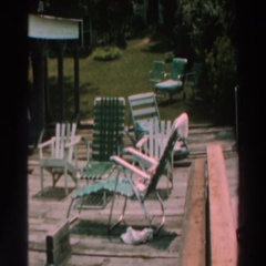 1964: magnificently colored chairs arranged in the meadow Stock Footage