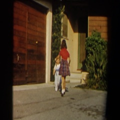 1958: children playing outside from their house. CALIFORNIA Stock Footage