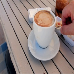 Romantic breakfast in a cafe on  beach. White coffee cup on wooden beach table Stock Footage