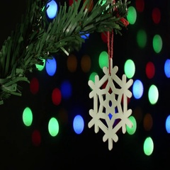Christmas tree decoration snowflake on the background of sparkling blurred Stock Footage