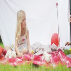4K 2 little girls having a tea party with their toys under a makeshift tent Stock Footage