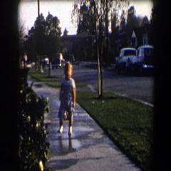 1958: toddler walking in puddles CALIFORNIA Stock Footage