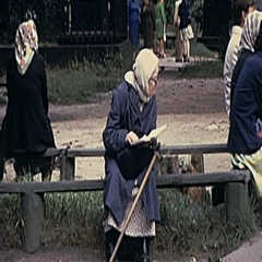 Moscow 1975: old woman read a book in a bench Stock Footage