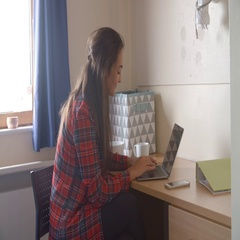 Female Student Working In Bedroom Of Campus Accommodation Stock Footage