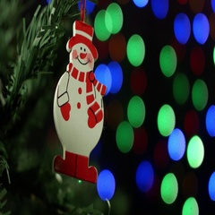 Christmas background with Christmas tree and snowman on background of blurred Stock Footage