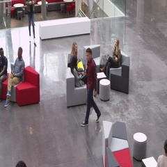 Students socialise and meet in a university lobby, shot on R3D Stock Footage