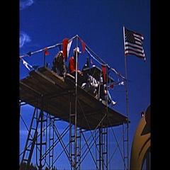 Vintage 16mm film, 1965 SCCA roadcourse viewing platform US flag Stock Footage