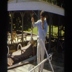 1966: single, young man shows off fish MADISON WISCONSIN Stock Footage