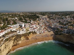 Aerial. Flight above the beach town of Carvoeiro. Portugal. Stock Footage