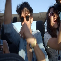 Three excited friends in the back of a car on a road trip Stock Footage