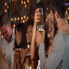 Friends having fun at a Christmas party in a bar Stock Footage