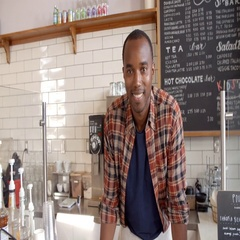 Business owner crosses arms at the counter of coffee shop Stock Footage