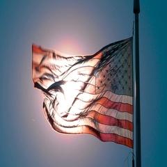 American Flag Waving Against Sun, 4K Stock Footage