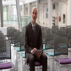 Businessman In Empty Auditorium Prepares Speech Shot On R3D Stock Footage