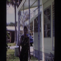 1966: person standing outside a structure talking and smiling Stock Footage