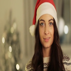Girl in santa hat portrait posing on tree lights background. , christmas holiday Stock Footage