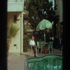 1966: an older gentlemen sitting by an outdoor pool PUERTO RICO Stock Footage