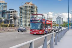 Sightseeing bus and cars on the bridge in Brisbane Stock Photos