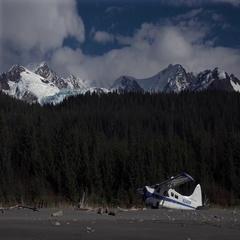 Alaska Bush Plane Sitting Idle and Glacier Timelapse Behind Stock Footage