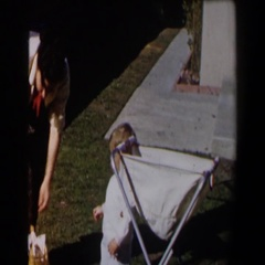 1958: mother doing laundry next to baby CALIFORNIA Stock Footage