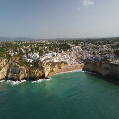 Aerial. Flying over the summer beach town of Carvoeiro. Portugal. Stock Footage