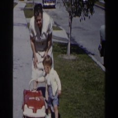 1958: mom and child enjoying the outdoors in the neighborhood LAS VEGAS Stock Footage