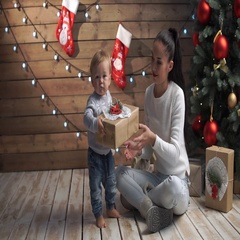 Pretty mother and her child warping xmas gifts Stock Footage