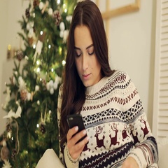 Portrait of a pretty woman using her mobile phone. High ISO image Stock Footage